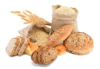 Assortment of baked bread over sack of wheat