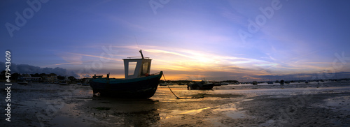 Large panorama of boats at low tide at Sandbanks in Poole