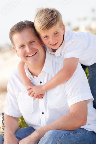 Cute Son with His Handsome Dad Portrait Outside