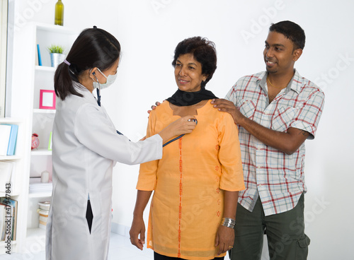 indian senior medical checkup with an asian female doctor