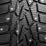 protector and snow spikes of winter tire poster