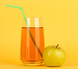 Useful apple juice with apples around on yellow background