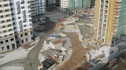 Builders work on building site of housing estate Losinyj island