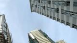 Many new buildings aspire upwards to sky poster