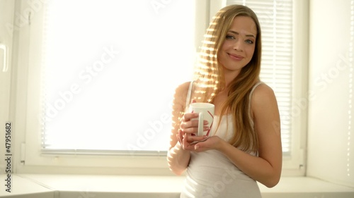 Attractive girl with a glass