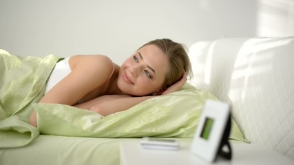 young beautiful girl on bed