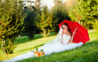 beautiful bride portrait with red umbrella