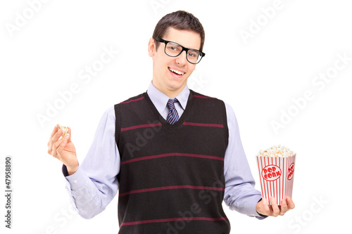 Smiling man eating popcorn