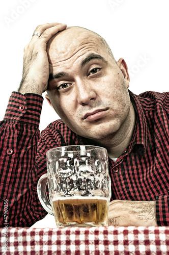 Sad beer drinker