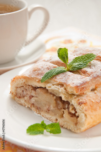 slice of an apple strudel with tea