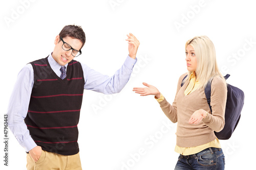 Young male and female student arguing