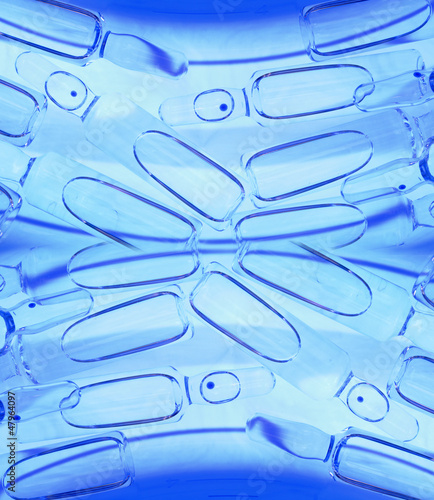 elegant healthcare  background. Medical ampules in the blue ligh