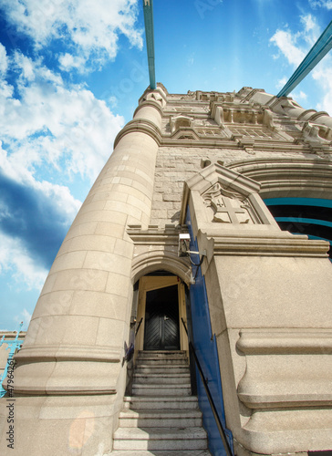 Powerful structure of Tower Bridge in London with clouds in the