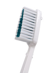 Toothbrush with Water Drops on White Background