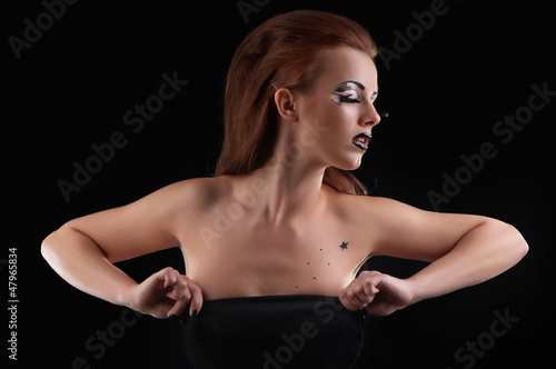 Fashion girl posing on dark background - portrait