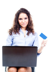 young and beautiful woman doing shopping online by credit card