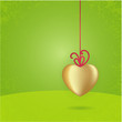 Vector Valentine's card. Golden heart on fresh green background.