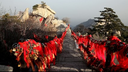 Red ribbons and locks along stair to Sacred mount, China