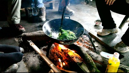 Cooking in a hut in village of minority Yao, Guangxi, China