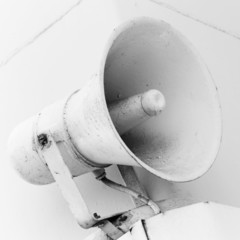 An old loudspeaker on the naval wall