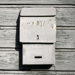 Traditional old mail box on the wooden wall
