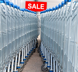Supermarket shopping carts with SALE text label