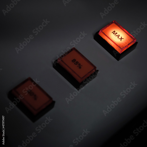 Illuminated max button on industrial power control panel
