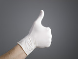 Hand with a latex glove expressing positivity