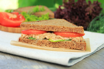 Rye bread sandwich with tuna, tomato slices and cucumber