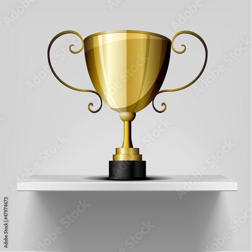 gold trophy on a shelf