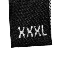 XXXL size clothing label tag, black fabric, isolated on white