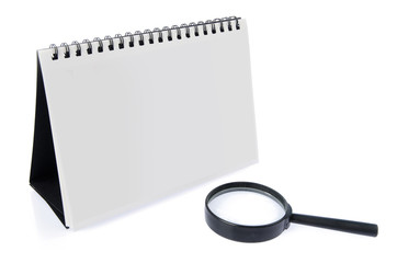 Desk Calendar and magnifier isolated on white
