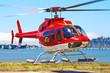 Startender Hubschrauber Bell 407 von malerischem Landeplatz - 47979280