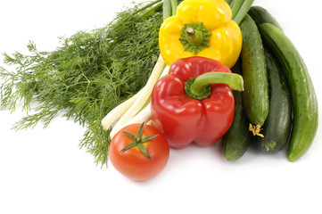 Fresh vegetables and red tomato on white