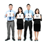 business team holding small blank paper poster