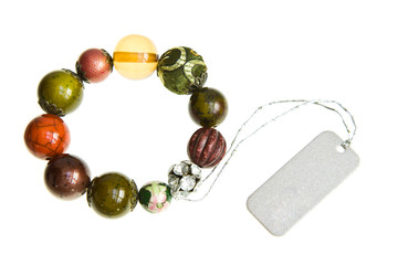 Stone bead bracelet on white background