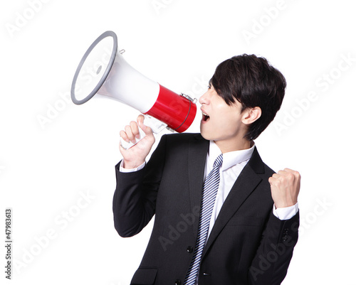 man shouting into megaphone and show fist
