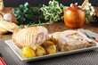 Roulade of stuffed chicken with potatoes and rosemary