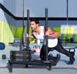 Crossfit sled push man pushing weights workout