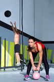 Crossfit gym Kettlebell woman and wall ball man