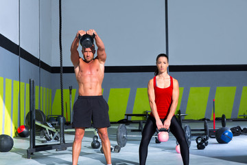 Kettlebells swing crossfit exercise man and woman
