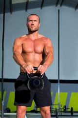 Crossfit Kettlebells swing exercise man workout