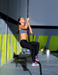 Crossfit rope climb exercise in fitness gym