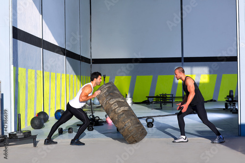 Crossfit flip tires men flipping each other