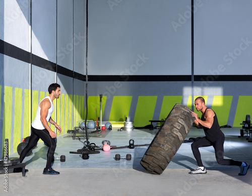 Crossfit flip tires men flipping each other