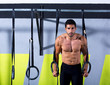 Crossfit dip ring man workout at gym