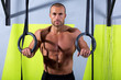 Crossfit dip ring man relaxed after workout at gym