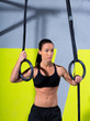 Crossfit dip ring woman relaxed after workout at gym