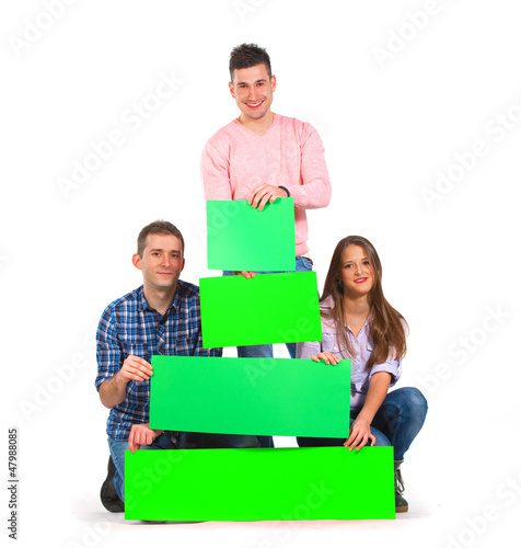 Group of people holding green tree shaped papers