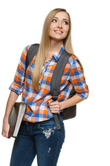 Smiling university student standing with backpack holding folder